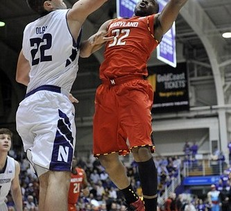 Nov 27, 2012; Evanston, IL, USA; Maryland Terrapins guard Dezmine Wells (32) is defended by Northwestern Wildcats center Alex Olah (22) during the first half at Welsh-Ryan Arena. Mandatory Credit: David Banks-US PRESSWIRE