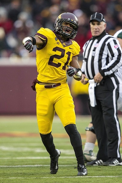 Nov 24, 2012; Minneapolis, MN, USA: Minnesota Golden Gophers defensive back Brock Vereen (21) celebrates after intercepting a pass in the first half against the Michigan State Spartans at TCF Bank Stadium.
