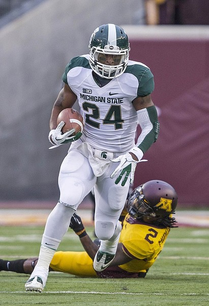 Nov 24, 2012; Minneapolis, MN, USA: Michigan State Spartans running back Le'Veon Bell (24) runs for a first down in the first half against the Minnesota Golden Gophers at TCF Bank Stadium. Mandatory Credit: Jesse Johnson-US PRESSWIRE