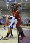 Nov 27, 2012; Evanston, IL, USA; Maryland Terrapins forward Charles Mitchell (0) is defended by Northwestern Wildcats guard Drew Crawford (1) during the first half at Welsh-Ryan Arena. Mandatory Credit: David Banks-US PRESSWIRE