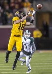 Nov 24, 2012; Minneapolis, MN, USA: DUPLICATE***Minnesota Golden Gophers wide receiver Derrick Engel (18)***Minnesota Golden Gophers linebacker Peter Westerhaus (18) jumps and catches a eight yard catch in the second half against the Michigan State Spartans at TCF Bank Stadium. Michigan State won 26-10. Mandatory Credit: Jesse Johnson-US PRESSWIRE
