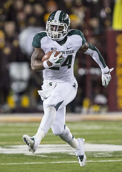 Nov 24, 2012; Minneapolis, MN, USA: Michigan State Spartans running back Le'Veon Bell (24) runs for a first down in the second half against the Minnesota Golden Gophers at TCF Bank Stadium. Michigan State won 26-10. Mandatory Credit: Jesse Johnson-US PRESSWIRE