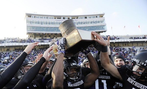 Nov 24, 2011; Evanston, IL, USA; Members of the Northwestern Wildcats raise the Land of Lincoln trophy after beating the Illinois Fighting Illini at Ryan Field. the Northwestern Wildcats defeated the Illinois Fighting Illini 50-14. Mandatory Credit: David Banks-US PRESSWIRE