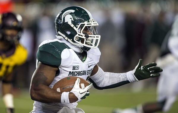Nov 24, 2012; Minneapolis, MN, USA: Michigan State Spartans running back Le'Veon Bell (24) runs with the ball for a five yard gain in the second half against the Minnesota Golden Gophers at TCF Bank Stadium. Michigan State won 26-10. Mandatory Credit: Jesse Johnson-US PRESSWIRE
