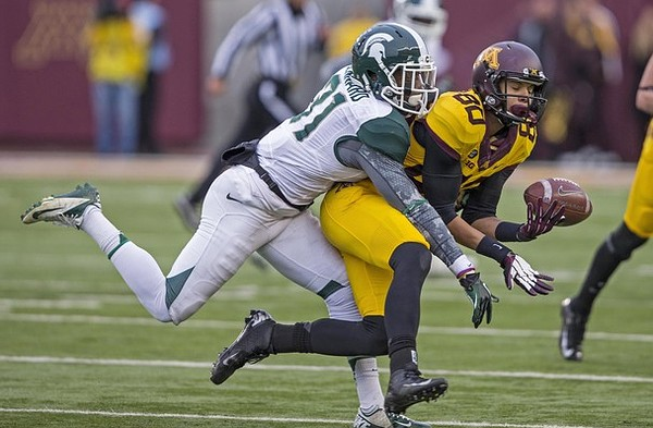 Nov 24, 2012; Minneapolis, MN, USA: Michigan State Spartans cornerback Darqueze Dennard (31) tips the ball away from Minnesota Golden Gophers wide receiver Devin Crawford-Tufts (80) in the first half at TCF Bank Stadium. Mandatory Credit: Jesse Johnson-US PRESSWIRE