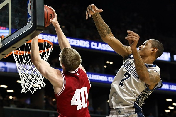 Nov. 20, 2012; Brooklyn, NY, USA; Indiana Hoosiers forward Cody Zeller (40) dunks the ball over Georgetown Hoyas forward Greg Whittington (2) during the first half at the Legends Classic Championship at Barclays Center. Mandatory Credit: Debby Wong-US PRESSWIRE