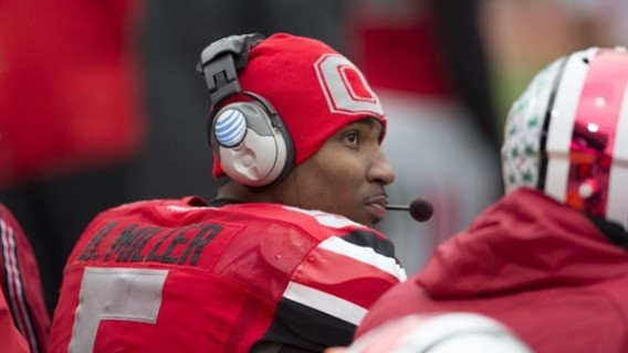 November 24, 2012; Columbus, OH, USA; Ohio State Buckeyes quarterback Braxton Miller (5) talks on a headset in the game against the Michigan Wolverines at Ohio Stadium. Ohio State won the game 26-21. Mandatory Credit: Greg Bartram-US PRESSWIRE