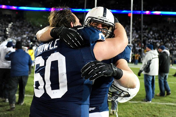 November 24, 2012; University Park, PA, USA; Penn State Nittany Lions running back Michael Zordich (9) celebrates with center Ty Howle (60) after beating the Wisconsin Badgers 24-21 at Beaver Stadium. Mandatory Credit: Evan Habeeb-US PRESSWIRE