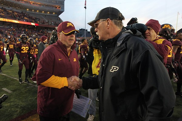 Oct 27, 2012; Minneapolis, MN, USA; Minnesota Golden Gophers head coach Jerry Kill and Purdue Boilermakers head coach Danny Hope shake hands following the game at TCF Bank Stadium. The Gophers defeated the Boilermakers 44-28. Mandatory Credit: Brace Hemmelgarn-US PRESSWIRE