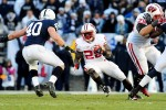 November 24, 2012; University Park, PA, USA;Wisconsin Badgers running back Montee Ball (28) runs with the ball while being pursued by Penn State Nittany Lions linebacker Glenn Carson (40) at Beaver Stadium. Mandatory Credit: Evan Habeeb-US PRESSWIRE