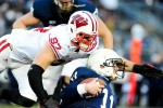 November 24, 2012; University Park, PA, USA; Penn State Nittany Lions quarterback Matt McGloin (11) is sacked by Wisconsin Badgers defensive lineman Brendan Kelly (97) at Beaver Stadium. Mandatory Credit: Evan Habeeb-US PRESSWIRE