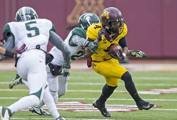 Nov 24, 2012; Minneapolis, MN, USA: Minnesota Golden Gophers wide receiver KJ Maye (4) gets tackled by Michigan State Spartans safety Kurtis Drummond (27) for a four yard gain in the first half at TCF Bank Stadium. Mandatory Credit: Jesse Johnson-US PRESSWIRE