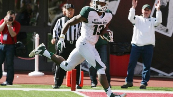 Oct 6, 2012; Bloomington, IN, USA; Michigan State Spartans wide receiver Bennie Fowler (13) scores a touchdown against the Indiana Hoosiers at Memorial Stadium. Michigan State defeated Indiana 31-27. Mandatory Credit: Brian Spurlock-US PRESSWIRE