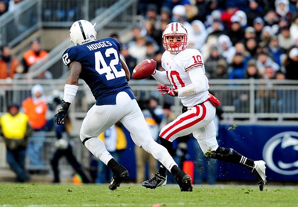 November 24, 2012; University Park, PA, USA;Wisconsin Badgers quarterback Curt Phillips (10) looks to throw a pass while being pursued by Penn State Nittany Lions linebacker Gerald Hodges (42) at Beaver Stadium. Mandatory Credit: Evan Habeeb-US PRESSWIRE