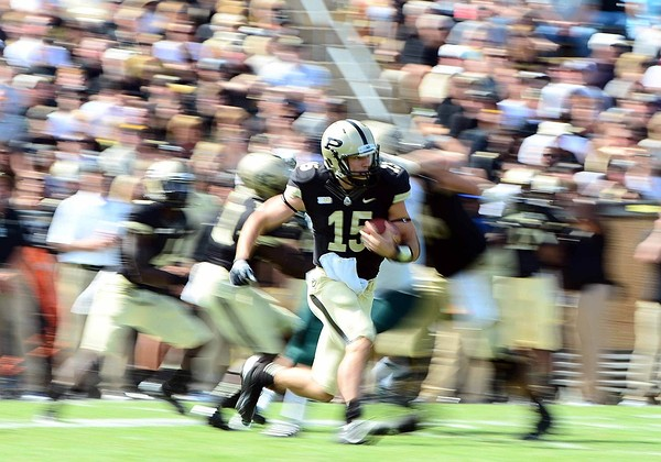 Sep 15, 2012; West Lafayette, IN, USA; Purdue Boilermakers quarterback Rob Henry (15) runs the ball in the fourth quarter against the Eastern Michigan Eagles at Ross Ade Stadium. Mandatory Credit: Andrew Weber-US Presswire