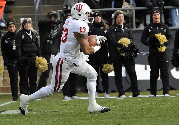 November 24, 2012; West Lafayette, IN, USA; Indiana Hoosiers wide receiver Kofi Hughes (13) runs back a kick off against the Purdue Boilermakers in Ross Ade Stadium. Mandatory Credit: Sandra Dukes-US PRESSWIRE