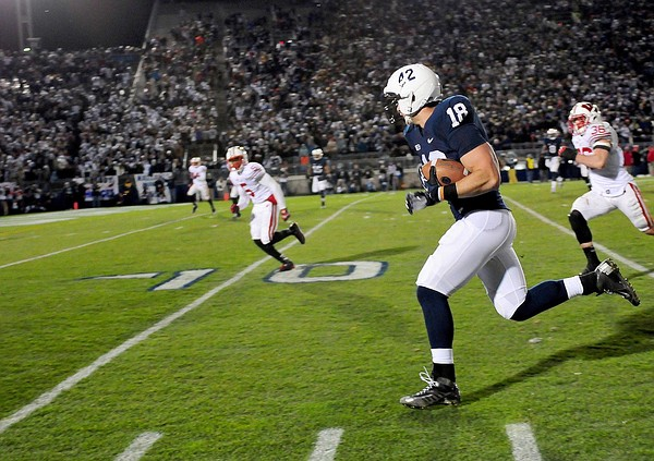 November 24, 2012; University Park, PA, USA; Penn State Nittany Lions tight end Jesse James (18) scores a touchdown against the Wisconsin Badgers at Beaver Stadium. Mandatory Credit: Evan Habeeb-US PRESSWIRE