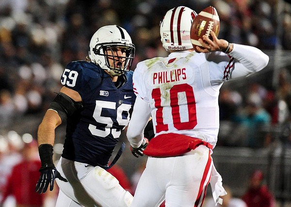 November 24, 2012; University Park, PA, USA; Penn State Nittany Lions defensive end Pete Massaro (59) chases Wisconsin Badgers quarterback Curt Phillips (10) at Beaver Stadium. Mandatory Credit: Evan Habeeb-US PRESSWIRE