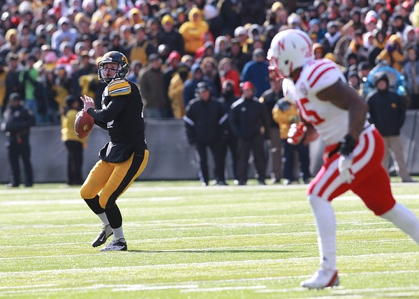 November 23, 2012; Iowa City, IA, USA; Iowa Hawkeye quarterback James Vandenberg(16) throws a pass against the Nebraska Cornhuskers at Kinnick Stadium.