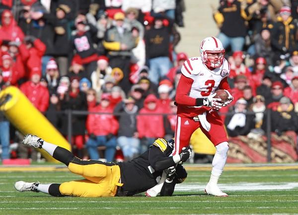 November 23, 2012; Iowa City, IA, USA; Nebraska Cornhuskers quarterback Taylor Martinez (3) is sacked by Iowa Hawkeyes safety Tom Donatell (13) at Kinnick Stadium.