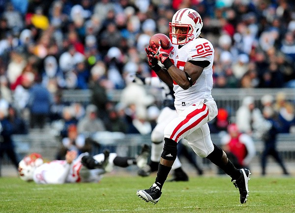 November 24, 2012; University Park, PA, USA;Wisconsin Badgers running back Melvin Gordon (25) catches a pass on the way to a 57 yard touchdown in the first quarter against the Penn State Nittany Lions at Beaver Stadium. Mandatory Credit: Evan Habeeb-US PRESSWIRE