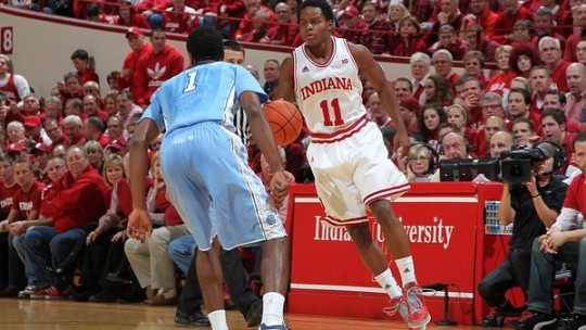 Nov 27, 2012; Bloomington, IN, USA; Indiana Hoosiers guard Yogi Ferrell (11) is guarded by North Carolina Tar Heels guard Dexter Strickland (1) at Assembly Hall. Mandatory Credit: Brian Spurlock-US PRESSWIRE