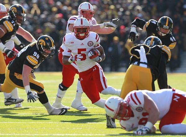 November 23, 2012; Iowa City, IA, USA; Nebraska Cornhuskers running back Braylon Heard (5) runs the football against the Iowa Hawkeyes at Kinnick Stadium.