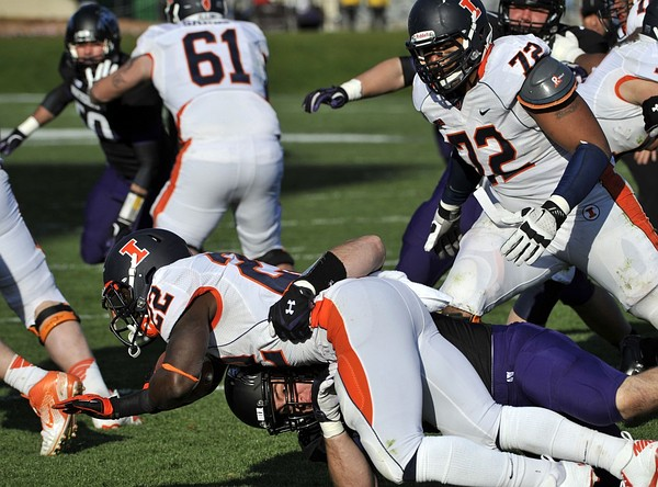 Nov 24, 2011; Evanston, IL, USA; Northwestern Wildcats defensive lineman Max Chapman (89) tackles Illinois Fighting Illini running back Dami Ayoola (22) for a safety during the second half at Ryan Field. the Northwestern Wildcats defeated the Illinois Fighting Illini 50-14. Mandatory Credit: David Banks-US PRESSWIRE