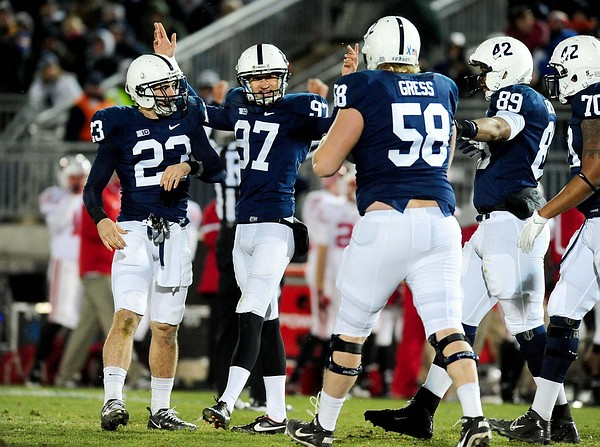 November 24, 2012; University Park, PA, USA; Penn State Nittany Lions kicker Sam Ficken (97) celebrates after kicking the go-ahead field goal in overtime against the Wisconsin Badgers at Beaver Stadium. Mandatory Credit: Evan Habeeb-US PRESSWIRE