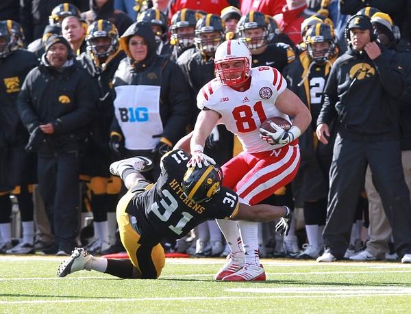 November 23, 2012; Iowa City, IA, USA; Iowa Hawkeye cornerback Anthony Hitchens (31) tackles Nebraska Cornhuskers tight end Ben Cotton (81) at Kinnick Stadium.