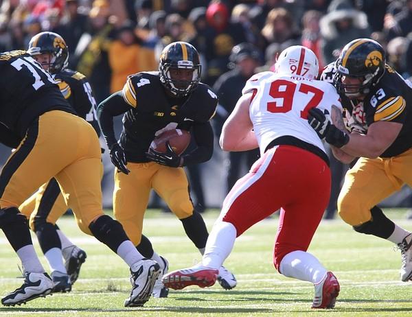 November 23, 2012; Iowa City, IA, USA; Iowa Hawkeye running back Greg Garmon (45) runs the football against the Nebraska Cornhuskers at Kinnick Stadium.