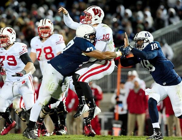 November 24, 2012; University Park, PA, USA; Wisconsin Badgers quarterback Curt Phillips (10) is hit by Penn State Nittany Lions defensive tackle Jordan Hill (47) at Beaver Stadium. Mandatory Credit: Evan Habeeb-US PRESSWIRE