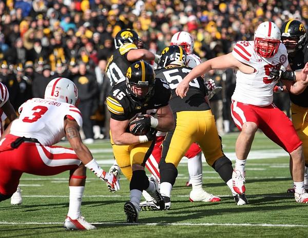 November 23, 2012; Iowa City, IA, USA; Iowa Hawkeye running back Mark Weisman (45) runs the football against the Nebraska Cornhuskers at Kinnick Stadium.