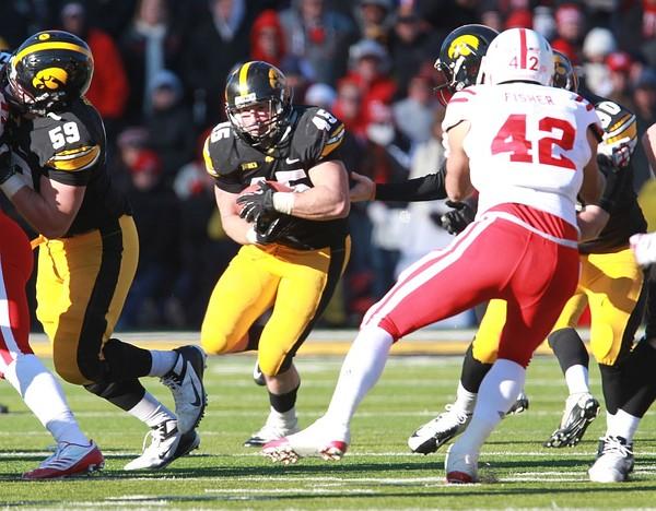 November 23, 2012; Iowa City, IA, USA; Iowa Hawkeye running back Mark Weisman (45) runs the football against the Nebraska Cornhuskers defense at Kinnick Stadium. Nebraska beat Iowa 13-7. Mandatory Credit: Reese Strickland-US PRESSWIRE