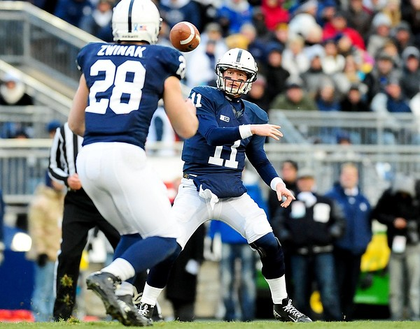 November 24, 2012; University Park, PA, USA; Penn State Nittany Lions quarterback Matt McGloin (11) throws a pass to running back Zach Zwinak (28) during the game against the Wisconsin Badgers at Beaver Stadium. Mandatory Credit: Evan Habeeb-US PRESSWIRE