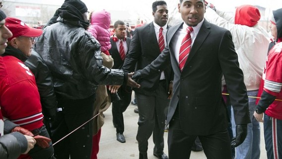 November 24, 2012; Columbus, OH, USA; Ohio State Buckeyes quarterback Braxton Miller (5) shakes hands with fans on his way into the stadium before the game against the Michigan Wolverines at Ohio Stadium. Mandatory Credit: Greg Bartram-US PRESSWIRE