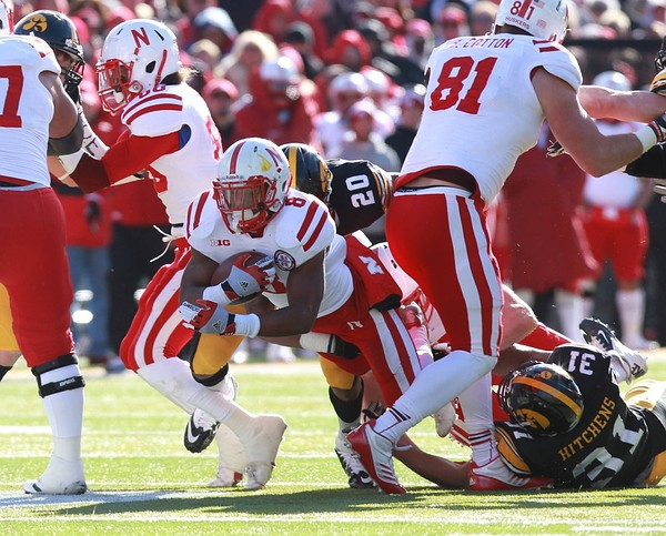 November 23, 2012; Iowa City, IA, USA; Iowa State Cyclones wide receiver Tobais Palmer (4) runs after a catch and avoids the tackle by Tulsa Golden Hurricanes defensive back Byron Moore (3) in the first quarter at Jack Trice Stadium.