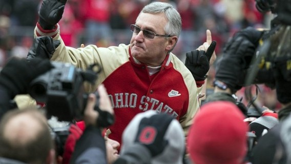 November 24, 2012; Columbus, OH, USA; Ohio State Buckeyes former coach Jim Tressel is held by players from his 2002 National Championship team in a game against the Michigan Wolverines at Ohio Stadium. Mandatory Credit: Greg Bartram-US PRESSWIRE