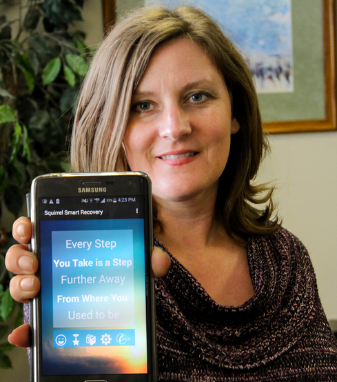 Brandi Spaulding shows off the Squirrel Smart Recovery app she worked on with OSU students.