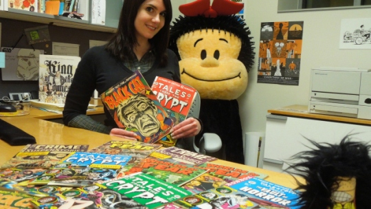 Caitlin McGurk, visiting curator of The Ohio State University's Billy Ireland Cartoon Library and Museum poses with collection