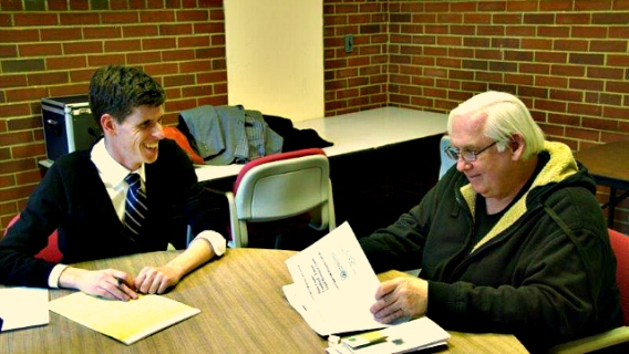 University of Wisconsin Veterans Law Center volunteer helping a client