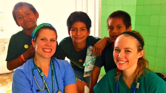 Students from Michigan State University's College of Osteopathic Medicine with young patients in Peru.