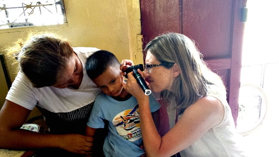 University of Nebraska audiologist Stacie Ray seeing a young patient in Nicaragua