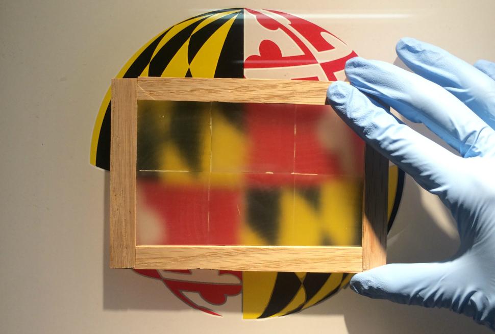 Wooden window pane over University of Maryland logo.
