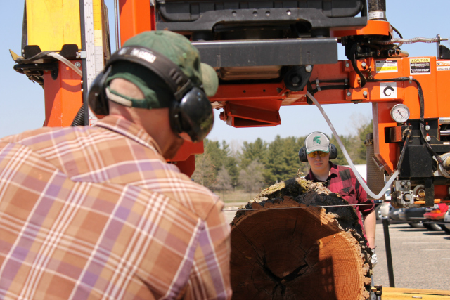 Michigan State University instructor and forestry student mill lumber