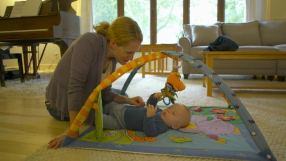 University of Wisconsin researcher Dr. Katie Brenner plays with her baby.