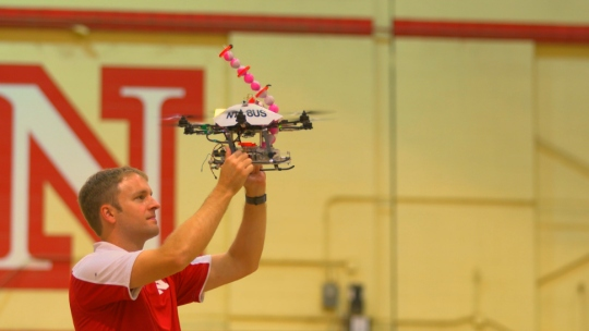 University of Nebraska student working on a fire-starting drone