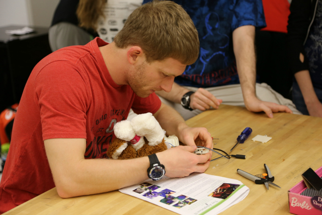 Ohio State University Toy Adaptation Program engineering student works on a toy.