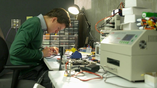 A student works in Northwestern University's Garage incubator space.