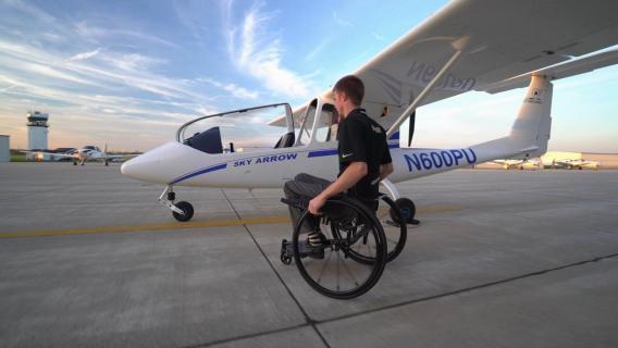 Purdue Able Flight pilot inspects his plane.